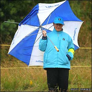 A marshall holds a broken umbrella