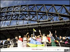The boat carrying the Pope passes under the Sydney Harbour bridge
