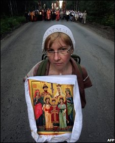A Russian holds an icon of Tsar Nicholas II and his family