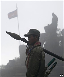 An armed Cambodian soldier stands in front of Preah Vihear temple on 17 July 2008