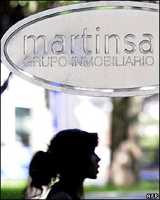 Woman walks past Martinsa outlet