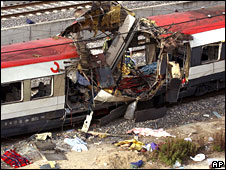 Debris beside damaged train carriage at Atocha railway station in Madrid, 11 March 2004