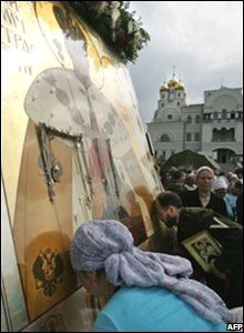 Russian Orthodox faithful kiss an icon of Russian Tsar Nicholas II
