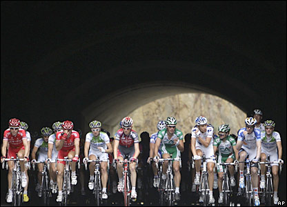 Tour de France riders come through a tunnel on stage 12