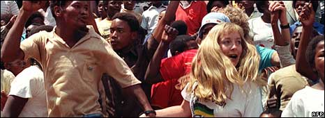 Black and white South Africans joined hands in dancing and singing 11 February 1990 at a mass African National Congress (ANC) rally in Soweto