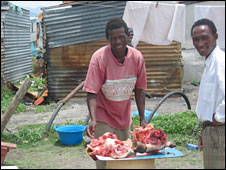 South Africans sell meat in the open air