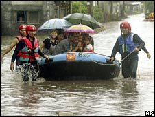 Residents in Wuri, Taichung county are rescued on Friday after Typhoon Kalmaegi brought flooding to Taiwan
