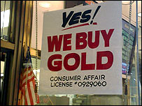 "Sign in shop window stating ""Yes! We buy gold"""
