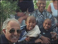 Ahmed Kathrada with his family and Nelson Mandela