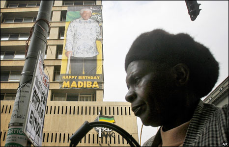 A poster wishing former Nelson Mandela a happy birthday is displayed on the front of the African National Congress headquarters in Johannesburg