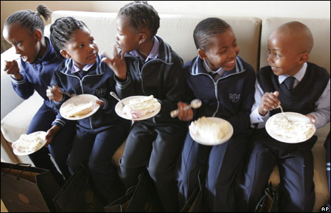 Children at the Bertrams Junior School in Johannesburg eat cake as they celebrate Nelson Mandela's birthday