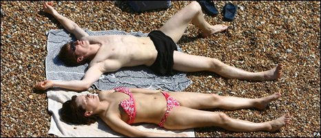 A man and woman sunbathing