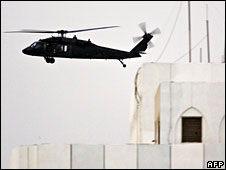 A US army UH-60 Black Hawk helicopter flies past a building as it leaves Baghdad's Green Zone, 10 July, 2008