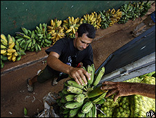 Workers unload bananas in Havana