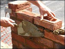 Man building a wall