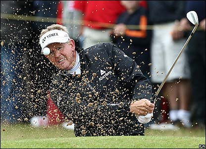 Colin Montgomerie plays out of a bunker at the 1st