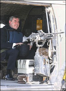 Gordon Brown behind a helicopter machine gun in Baghdad, Iraq