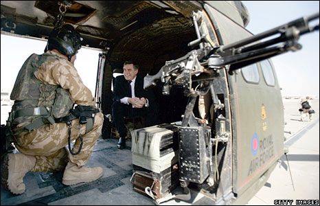 Gordon Brown speaks to a British serviceman on board a helicopter in Iraq