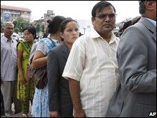 Information Minister Krishna Bahadur Mahara, in  white, waits to vote