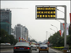 An electronic billboard shows details of traffic control measures, Beijing, 20 July