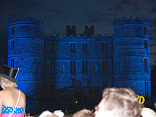 Lulworth Castle lit in blue during Camp Bestival on Saturday