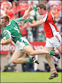 Fermanagh's Martin McGrath and Ronan Clarke of Armagh