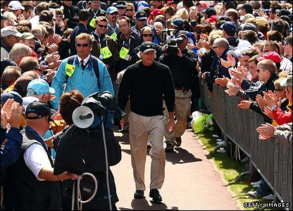 A huge crowd greets overnight leader Greg Norman as he makes his way to the opening tee