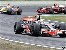 Lewis Hamilton leads Nelson Piquet Jr and Felipe Massa in the closing stages of the German Grand Prix