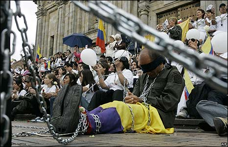 A demonstrator in Bogota in chains and a blindfold