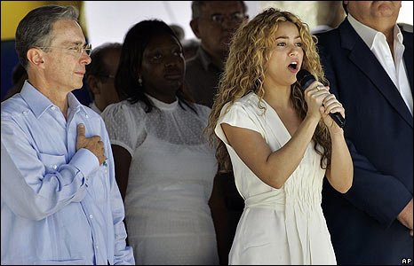 Colombian pop star Shakira sings the Colombian national anthem during the Independence Day celebrations in Leticia