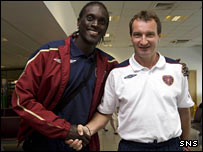 David Obua with Hearts manager Laszlo Csaba