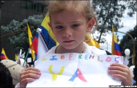 Girl at Bogota rally, picture by Carl Edlund Anderson
