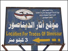 A sign showing the way to the prints on the outskirts of Madar village