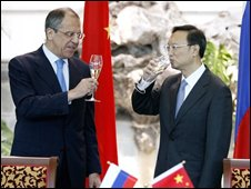 Russian Foreign Minister Sergey Lavrov, left, drinks a toast with Chinese Foreign Minister Yang Jiechi after they signed documents on a border agreement