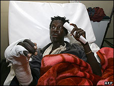 "A supporter of Zimbabwe""s opposition Movement for Democratic Change (MDC) lays in hospital in Ruwa, on July 7, 2008. The man (no name given) said that men with masks attacked him."