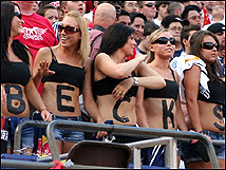 Fans with BECKS spelled out on their midriffs