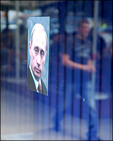 A portrait of Russia's Vladimir Putin in a Mitrovica window