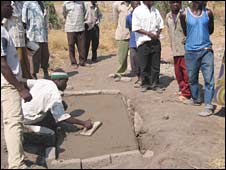 A man builds Nyerere Rutahiro's grave