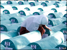 A Bosnian Muslim woman weeps among coffins of Srebrenica victims during a funeral ceremony (11/07/08)