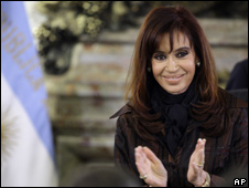 President Cristina Fernandez de Kirchner applauds the handover of Aerolineas Argentinas airline company in Buenos Aires