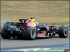 Mark Webber's Red Bull trails smoke prior to his retirement from the German Grand Prix