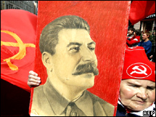 A Russian woman carries a portrait of Soviet leader Josef Stalin in a Victory Day celebration in Moscow on May 9, 2008
