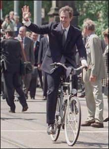Tony Blair riding a bike in Amsterdam in 1997
