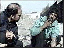 Arash Alaei speaking to a drug user in Tehran