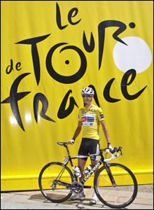 Overall leader Frank Schleck of Luxembourg poses in the Tour de France's yellow jersey