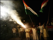 "Supporters of India""s Congress party celebrate after the Congress Led UPA government won a parliamentary confidence vote in New Delhi on July 22, 2008"