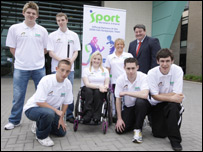 Seven of NI's paralympians with acting Sport NI chairman Dominic Walsh