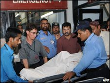 Police with the body of Mr Shahenshah