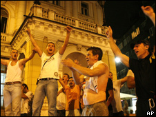 Residents of Sarajevo celebrate early on Tuesday after the arrest of Radovan Karadzic