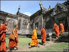 Monks walk through the temple on 21 July 2008